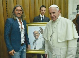 Fabian Perez with Pope Francis. Perez was commissioned by the Vatican to paint the Pope.