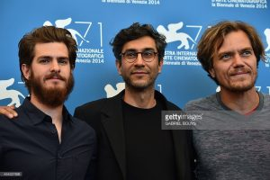 Ramin Bahrani (c) at the premiere of 99 Homes, which he wrote and directed, starring Andrew Garfield (L) and Michael Shannon (R). Image Credit AP
